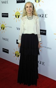 Franca Sozzani chose a tiered black skirt and a long-sleeve white blouse for the Dream for Future Africa Foundation Gala.