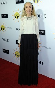 Franca Sozzani went for vintage elegance in a long-sleeve white blouse with lace inserts paired with a tiered black skirt.