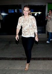 Hilary Duff chose a casual camouflage print top while shopping in LA.