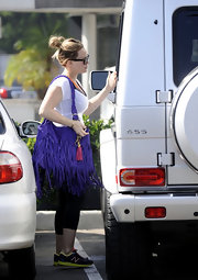Hilary Duff added a wild pop of color to her casual threads with a purple fringed bag.