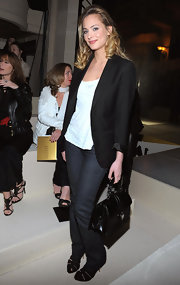 Nora Arnezeder kept it simple yet chic in a black blazer, white blouse, and jeans at the ETAM 2010 fashion show.