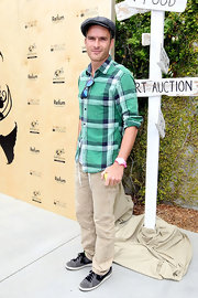 Balthazar Getty arrived at the Earth Day Celebration in Santa Monica in a green plaid button-down shirt.