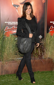 Gina Gershon's studded black hobo bag provided an edgy finish to her look during the 'Eastbound and Down' season 2 premiere.