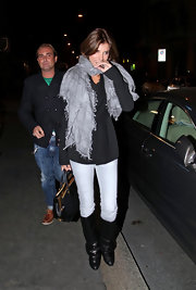 Elisabetta Canalis kept a low profile in Milan in slouchy white leggings and black knee high boots.