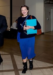 Elizabeth Moss opted for a royal blue light and flowing skirt for her travel look at LAX.