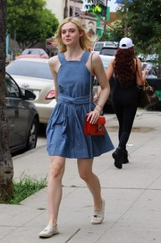 Elle Fanning cut a cute figure on the streets of Studio City in this belted denim mini dress.