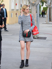 Elle Fanning went for a tough finish with a pair of black combat boots.