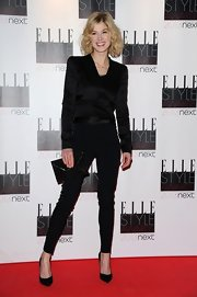 A classic black envelope clutch topped off Rosamund Pike's all black look.