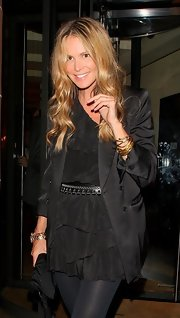 Elle MacPherson's wavy, caramel-colored tresses were super shiny while out on the town in London. To keep hair sleek and healthy, we recommend a shine-enhancing product like Carol's Daughter Macadamia Finishing Shine Mist.