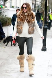 Elle MacPherson went for a double dose of the fur trend in a pair of tan fur-trimmed boots and an of the moment furry vest.