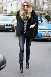 Elle MacPherson strolled through West London in fierce black leather and suede mid-calf boots.