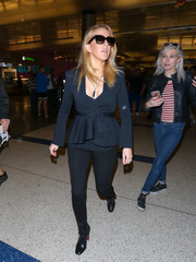 Ellie Goulding sealed off her airport look with a pair of studded black boots by Christian Louboutin.