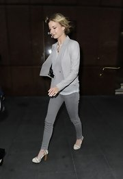 Emily VanCamp strode through Sydney wearing a pair of crisp white and tan striped pumps.