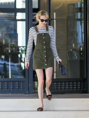 Emma Roberts looked cute and youthful in a moss-green pinafore dress by ASOS while out shopping.