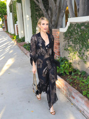 Emma Roberts paired her dress with brown peep-toe heels by Jimmy Choo.