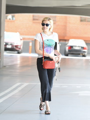 For a pop of color, Emma Roberts accessorized with a red cross-body bag by Clare V.