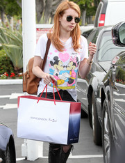 Emma Roberts accessorized with a pair of Ray-Ban shades for a day of shopping.