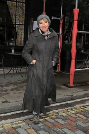Emma Thompson posed for pictures even in the rain as she was sporting an ankle-length raincoat.