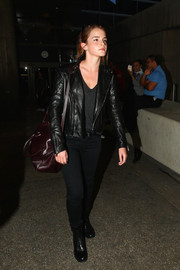 Emma Watson finished off her rocker-chic airport look with black lace-up boots by Saint Laurent.