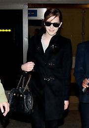 Emma Watson maintained her monochromatic look with a black chain strap purse.