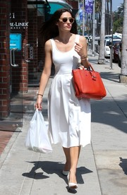 Emmy Rossum looked effortlessly chic in a sleeveless LWD teamed with a red tote while out and about in Beverly Hills.
