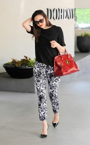 Emmy Rossum teamed her top with black-and-white floral pants for a more stylish look.