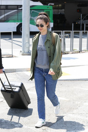 Emmy Rossum was casual and edgy in a Smythe army jacket layered over a gray Rebecca Minkoff sweatshirt during a flight to LAX.