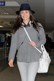Emmy Rossum topped off her airport look with a cute blue fedora.