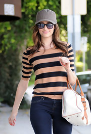 Emmy Rossum shielded her gaze in a pair of classic and budget friendly wayfarer shades.
