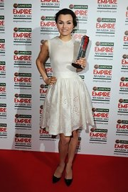 Samantha Barks chose an ivory frock with a Peter Pan collar and eyelet skirt for her fun and flirty red carpet look.