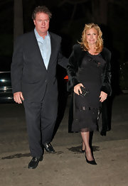 Kathy Hilton amped up the elegance with a black velvet evening coat at the Endeavor pre-Oscar party.