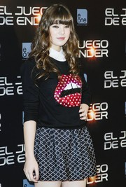 Hailee Steinfeld stuck to a youthful look with an embellished crewneck sweater and a patterned mini skirt when she attended the 'Ender's Game' photocall in Madrid.