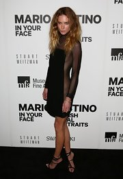 Erin Wasson bares it all, or well, most of it in this black mesh dress at the Mario Testino exhibit.