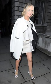 Laura Whitmore looked modern wearing a white coat over a tiered cocktail dress at the Esquire Summer Party.