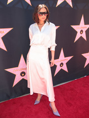 Victoria Beckham was classic in a white button-down shirt from her label during Eva Longoria's Hollywood star ceremony.