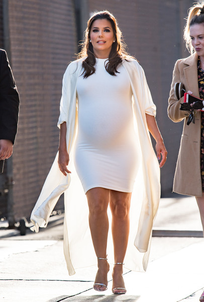 Eva Longoria styled her white outfit with silver ankle-strap sandals.