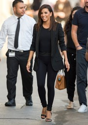 Eva Longoria teamed black leggings with an oversized tux jacket and a fitted top for her 'Jimmy Kimmel Live!' appearance.