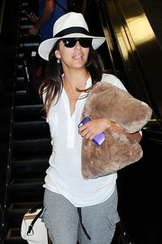 Eva Longoria kept a low profile with a black-and-white fedora and dark glasses while making her way through LAX.