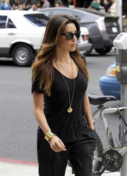 Eva Longoria went for a stroll sporting a chic gold cuff by Hermes.