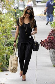 Eva Longoria teamed her tee with a cool pair of harem pants.
