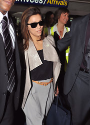 Eva has a wrap on fashion in this tan leather double-strap belt.