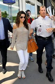 Eva Longoria showed off her sexy street style in this off-the-shoulder sheer sweater.