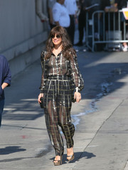 Evangeline Lilly completed her sexy look with matching sheer pants.