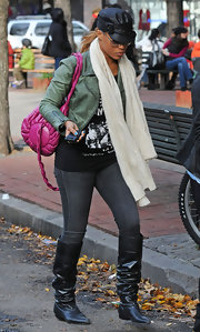 Eve showed off her street style with this leather jacket, scarf, jeans, and slouchy knee-high boots combo.