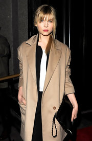 Clemence Poesy wore her long blond hair in a casual loose ponytail at the British Film Awards.