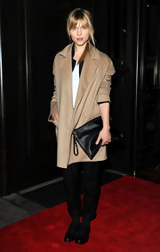 Clemence Poesy toyed with menswear in an oversize khaki blazer.