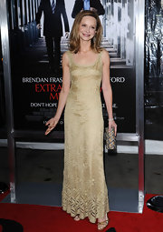 Calista Flockhart chose a gold mesh gown for her red carpet look at the premiere of 'Extraordinary Measures.'