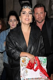 Lady Gaga matched her earrings with a bejeweled headband.