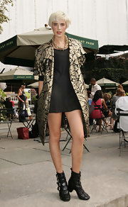 Agyness paired her gilded dress coat with buckled ankle boots.