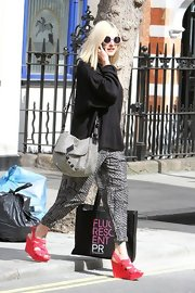Fearne Cotton leaves her studio in London wearing a pair of strappy red wedge sandals.